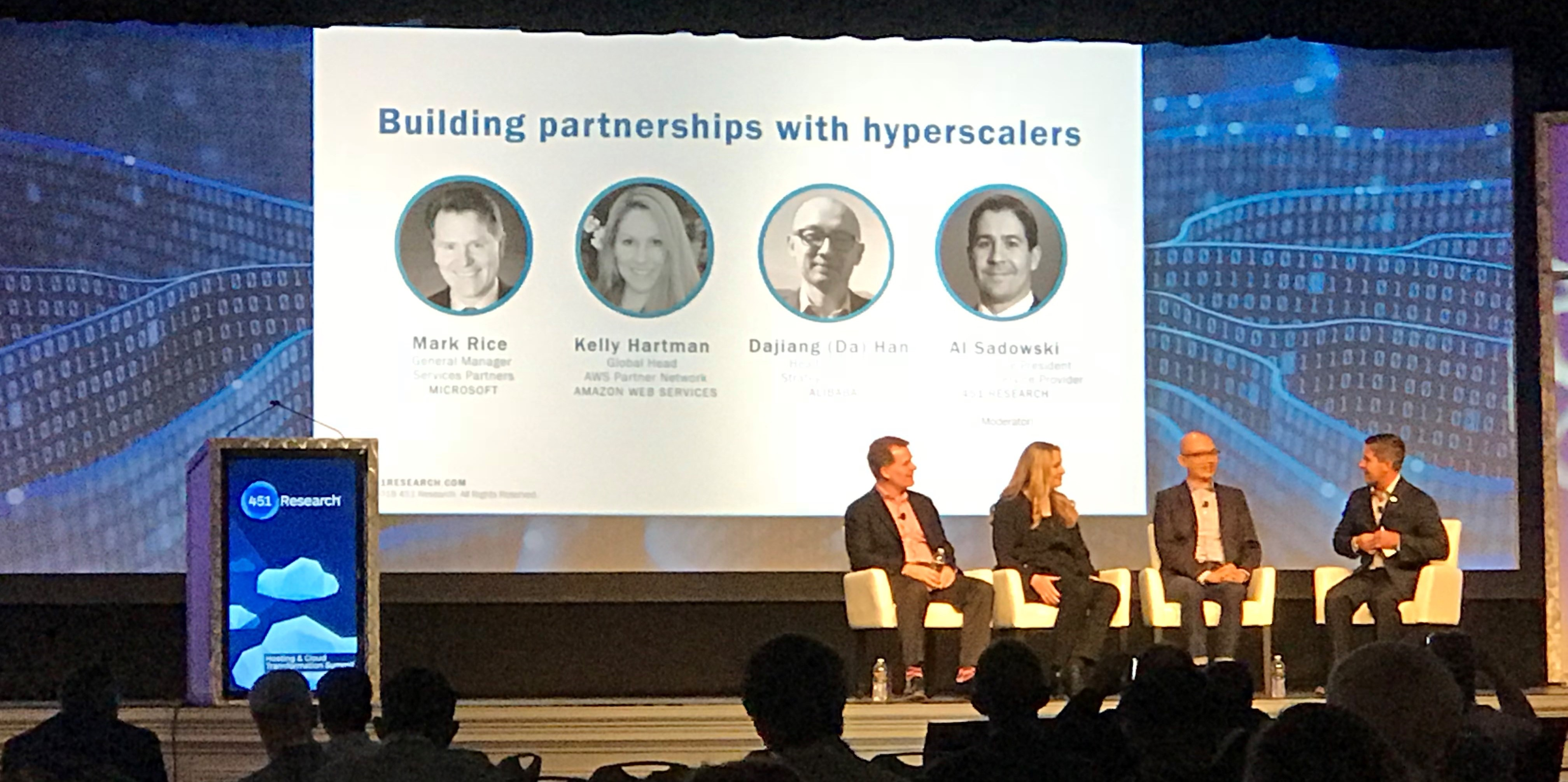 Figure 1 (from left to right) Mark Rice, General Manager of Services Partners at Microsoft; Kelly Hartman, Global Head of the AWS Partner Network at AWS; Daijiang (DA) Han, Head of Global Strategic Alliances at Alibaba Cloud; and Al Sadowski, Research Vice President at 451 Research presenting at HCTS 2018